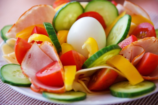 A colorful plate of fresh sliced vegetables