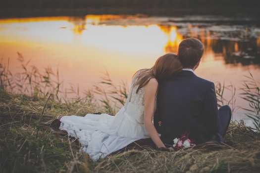 Couple on lakeside cuddling