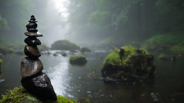 rock cairn in calm water